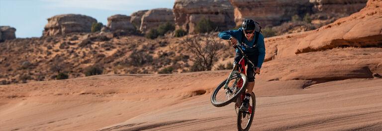 Mountain biker rides in the desert with his Camelbak