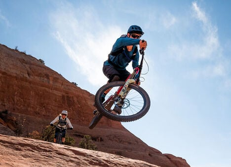 Two mountain bikers.