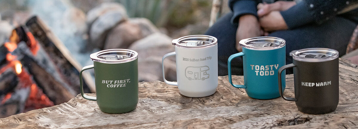 Four custom camp mugs with engraving.