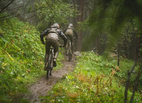 Two people biking on a trail.