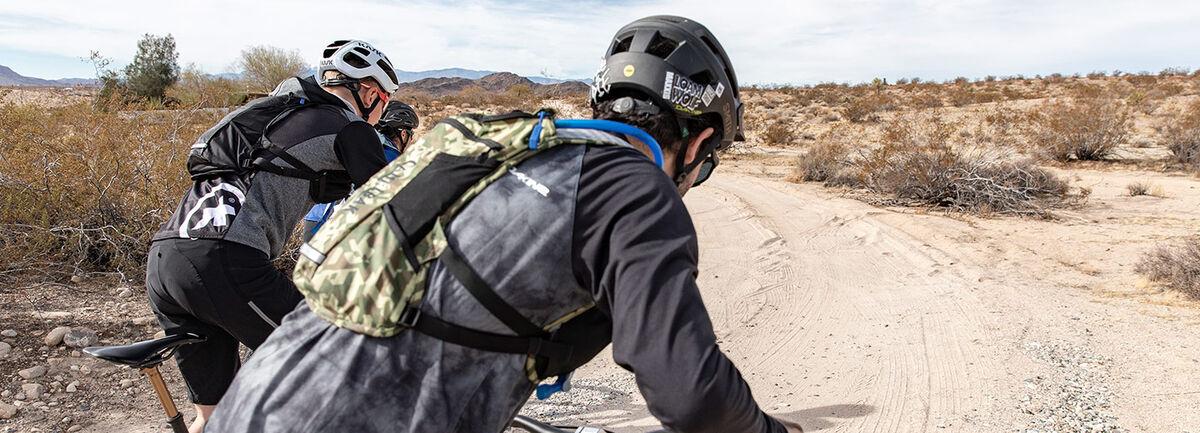 Three Bikers on a dirt road.