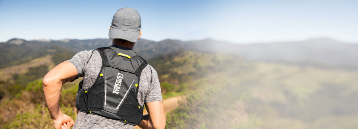 Man running wearing a hydration vest.