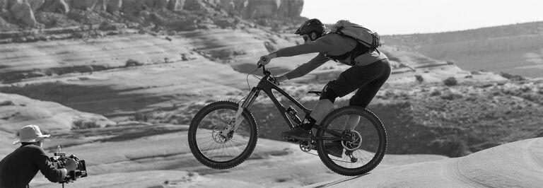 Cameraman films mountain biker
