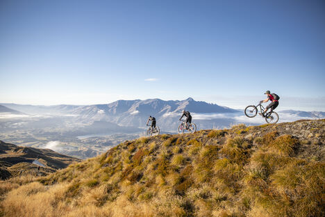 Image of three bike riders on a mountain trail.
