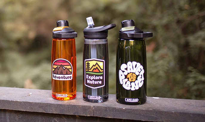 Three custom water bottles lined up with different printed images and text.