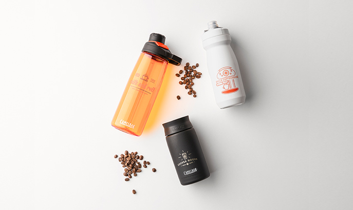 Three custom water bottles with coffee beans.