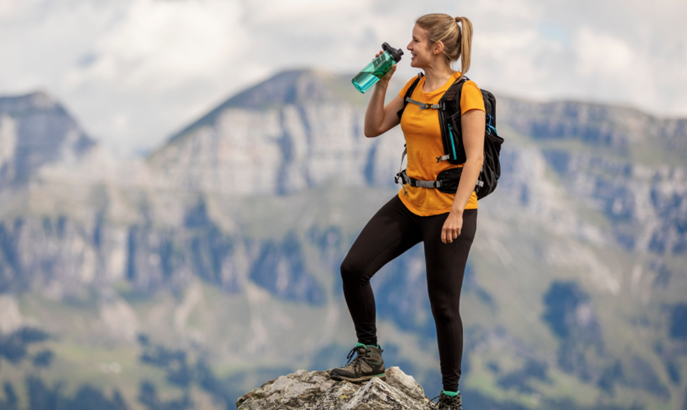 Woman hiker at the tip of a peak.