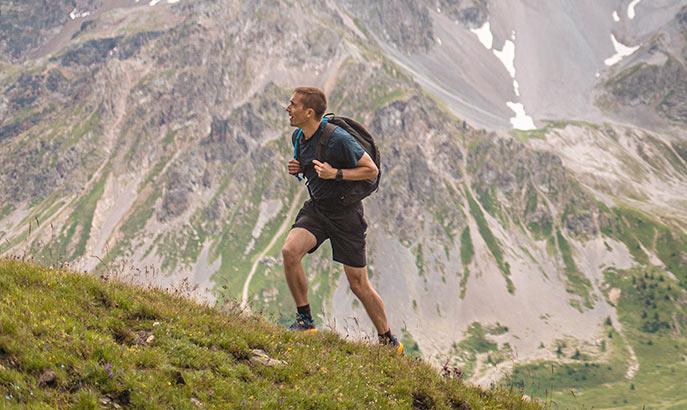 Man hiking on mountain.