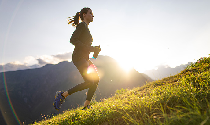 Woman running in the mountains.