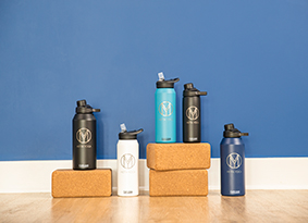 Five stainless steel custom water bottles with yoga blocks.
