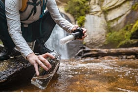 A person filling up an Eddy® + filtered by LifeStraw®, 32oz Bottle with Tritan™ Renew.