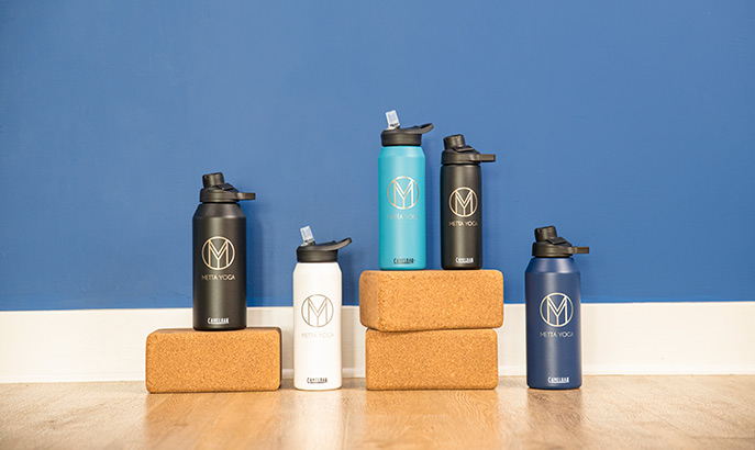Five insulated stainless steel custom water bottles with yoga blocks.