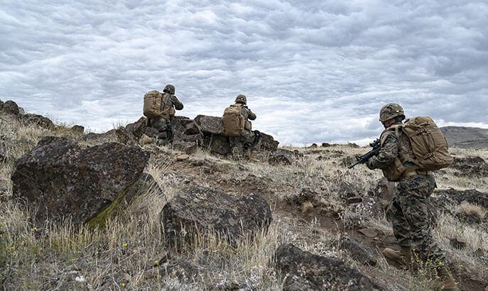 Three Men on a Hill.